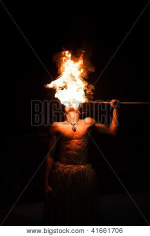 Man demonstrates the fire breathing portion of their act