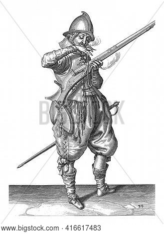 A soldier on duty, full-length, to the right, holding a rudder (a type of firearm) with his left hand, With his right hand he brings a burning wick to his mouth to clean it blow, vintage engraving.