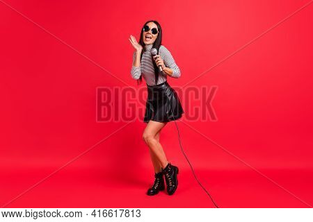 Full Length Photo Of Crazy Funky Young Lady Hold Mic Celebrity Sing Karaoke Isolated On Red Color Ba