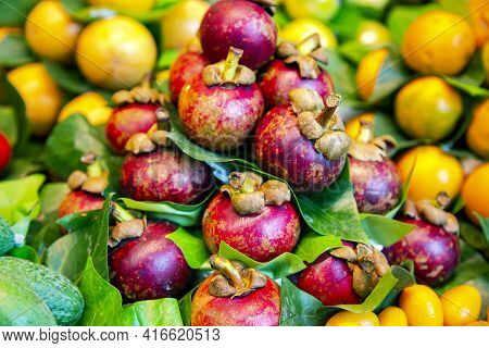 Fresh Ripe Mangosteens And Other Seasonal Fruits At The La Boqueria Market In Barcelona, Spain. La B
