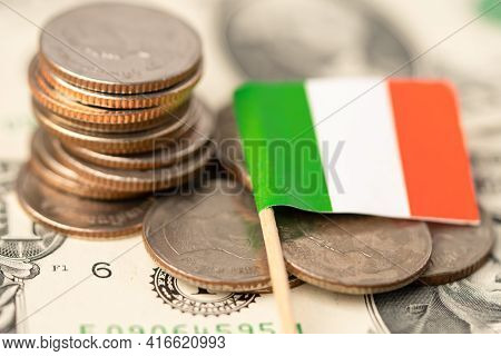 Stack Of Coins With Italy Flag On Italy Dollar Banknotes.