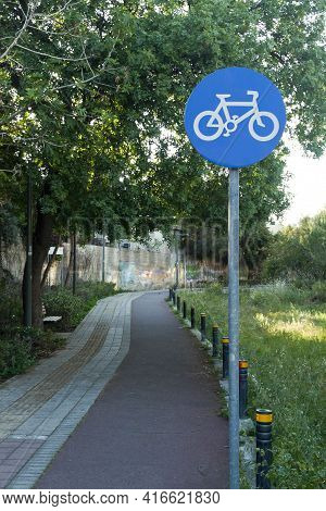 Blue Regulatory Sign For Cyclists In Public Park