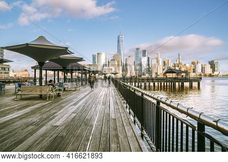 Jersey City, Nj - Usa - Feb. 27, 2021: Landscape Sunset View Of People Enjoying The Riverfront At J