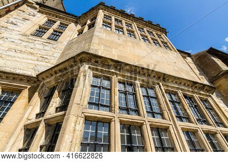 Front Elevation Of Ancient Stone Building Blue Sky.
