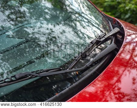 Close Up Of Car Windshield Wipers In Red Car