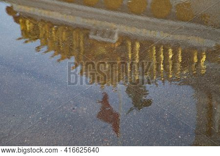 Pavilion Vdnh Ussr -reflection In A Puddle