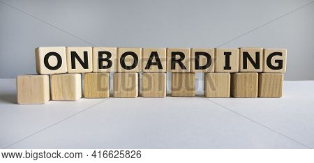 Onboarding Symbol. The Word 'onboarding' On Wooden Cubes. Business And Onboarding Concept. Beautiful