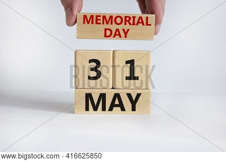 Memorial Day Symbol. Male Hand Puts A Block With The Inscription 'memorial Day' On Cubes With The Da