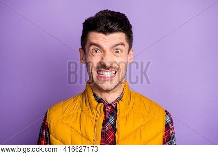 Photo Of Angry Furious Young Man Wear Yellow Sleeveless Jacket Showing Tooth Teeth Isolated Violet C