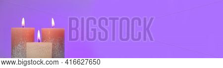 Candles Banner . Festive Glitter Candles On A Purple Background. Candle Flame. Copy Space.online Can