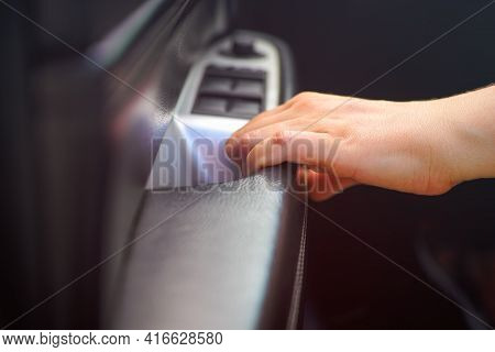 Person Hand On Car Interior Door Handle. Close-up