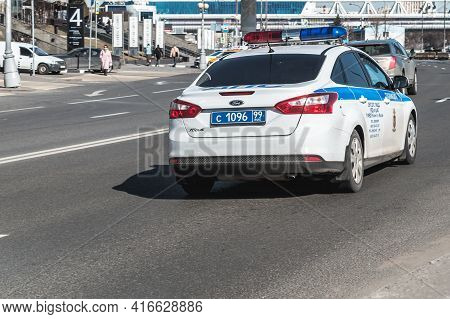 Moscow, Russia - March 2021: Police Car Drives On High Speed On The Road With Motion Blur Effect. Ba