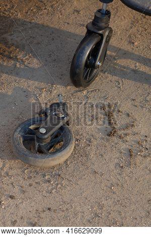 Old Broken And New Pram Wheel, Pram Wheel Replacement