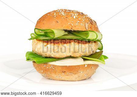 Fishburger Fish Burger With Cod Cutlet Cucumber Lettuce Goat Cheese Dzatziki Tartarus Sauce And Grai