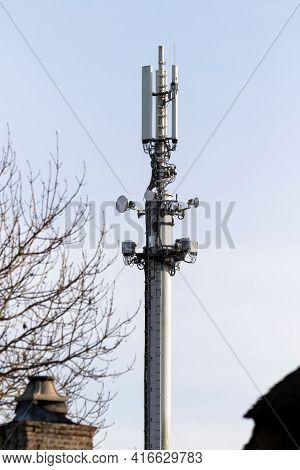 A Closeup Portrait Of A Top Part Of A Telephone Mast Or Transmission Tower Standing Tall In The Blue