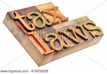 tax laws - isolated word abstract in vintage letterpress wood type, business and finance concept