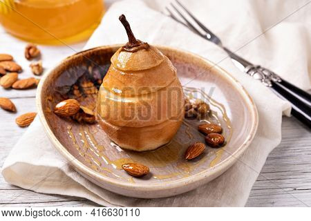Sweet baked pears with honey, nuts, cranberries and cinnamon