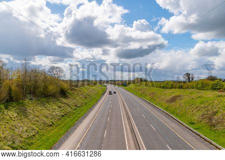 Countryside Lanscape. Empty Motorway And Cloudy Sky .