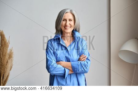 Happy Laughing Mature Elder 60s Business Woman Standing Indoors. Senior Mid Age Older Stylish Look W