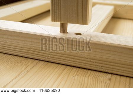 Assembly Parts Made From Pine Wood. Bars Have Holes. Сonstruction Fasteners Are Inserted Into Holes.