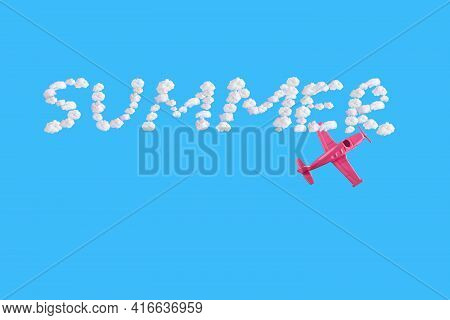 Pink Airplane Goes Into A Sharp Turn On Blue Background And Word Summer Of Abstract Shapes Of Cloud.