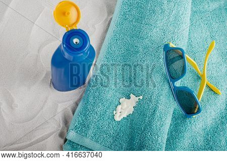 Cosmetic Stain Sunscreen Lotion Spilling On A Turquoise Towel. Daily Life Dirty Stain For Wash And C