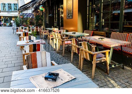 Close Up Of An Empty Tables With Empty Chairs At A Local Outdoor Resturant In Bucharest, Romania, 20