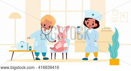 Kids Playing Doctor. Boy And Girl In Medical Uniform Treat And Examine Toy Rabbit In Room, Therapist