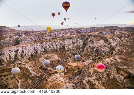 Cappadocia, Turkey-23 Oct. 2020: Hot air balloon flying over rock landscape at Cappadocia Turkey