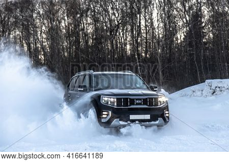 Moscow, Russia - February 15, 2021: Kia Mohave 2021 Black Suv Drives In A Controlled Drift. Drift On
