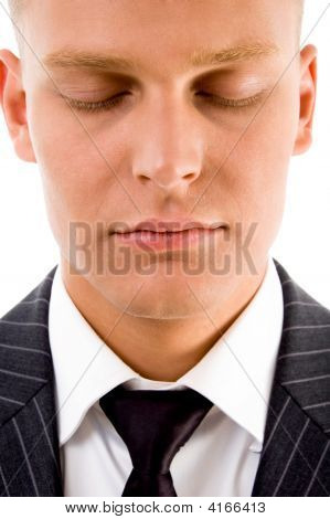man posing with closed eyes on an isolated background poster
