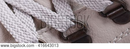 Lace-up Laces On Beige Boots With Metal Clips