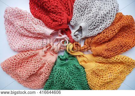 Colorful String Bags, Shopping Bag On A White Background, Photo From Above. Colorful String Bags, Co