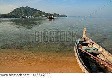 A Local Fishing Boat On The Beach., Traditional Fishing Boats On The Coast At Dawn To Wait For The N