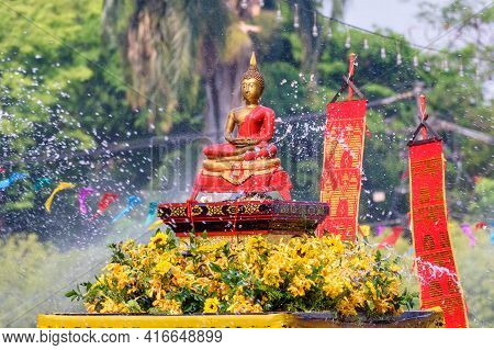 The Tradition Of Bathing The Buddha On An Annual Basis Chiang Mai Songkran Festival, Thailand.