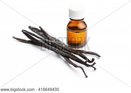 Vanilla pods and vanilla essence in glass bottle isolated on white background.