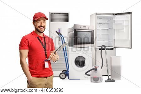 Sales clerk in an electircal home appliances store smiling at camera isolated on white background