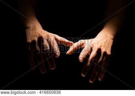 Puppeteers Hands On A Black Background, Contrasting Light
