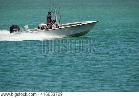 Fisherman In An Open Fishing Ski Powered By A Single Outboard Engine Speeding On The Florida Intra-c