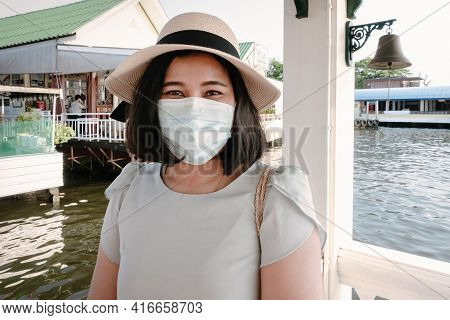 Smile Tourist Woman Having Fun While Sightseeing Bangkok Cityscape Beside The River, Portrait Of Hap