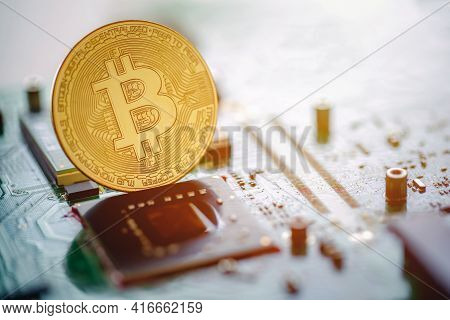 Golden Coins With Bitcoin Symbol On Mainboard. Digital Cryptocurrency Online, Virtual Future Currenc