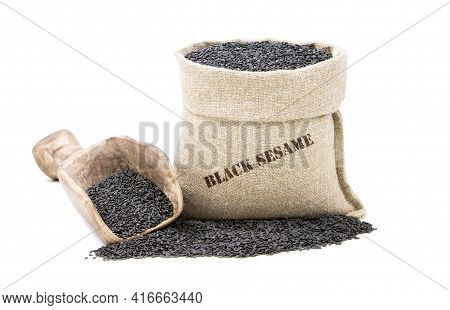 Seeds Of Black Sesame In A Sack Isolated On A White Background. Unpeeled Sesame Seeds. Black Sesame