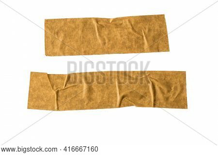 Two Pieces Of Crumpled Adhesive Tape Isolated On A White Background. Universal Packaging Tape.