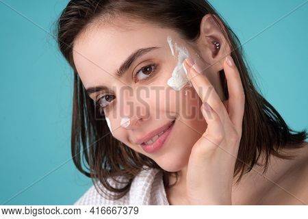 Beautiful Woman, Female Skin Care, Close Up Face Beauty Closeup Portrait. Girl Apply Facial Cream Li