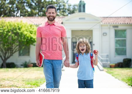 Parent And Pupil Of Primary School Go Hand In Hand. Father And Son Go To School, Education And Learn