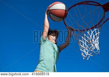 Kid Little Boy Basketball Player Making Slam Dunk During Basketball Game