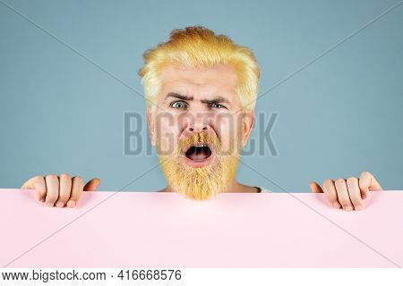 Funny Man Holding Blank Sheet. Discount. Smiling Man Holding Empty Blank Paper Board With Copy Space