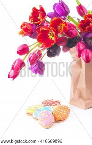 Beautiful Bouquet Of Purple Tulips In Paper Bag, Isolated On White