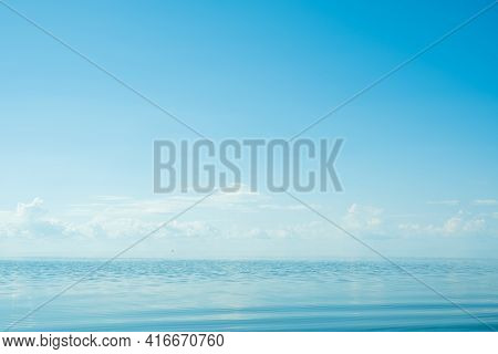 Beautiful Sunset On The Sea Coast. The Sun Reflecting On The Sea. Nature Background. Banner.