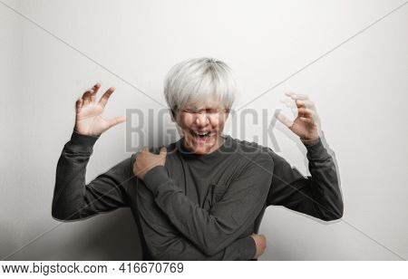 Conceptual Motion Blurred Photo Of Crazy Person. Bipolar Disorder. Mental Health And Psychology Conc